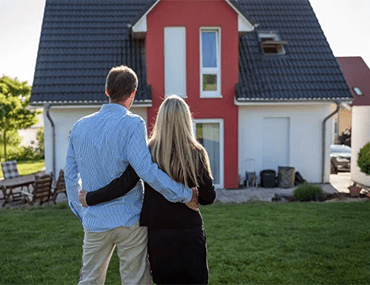 Couple looking at a house